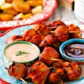 Bacon Wrapped Chicken and Easy Dips on tray with sauces