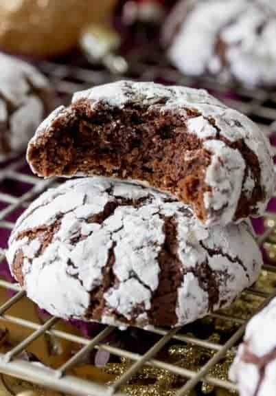 Richly fudgy chocolate crinkle cookies, studded with mini chocolate chips (for extra chocolate flavor), and rolled in powdered sugar! These are a classic holiday (or anytime) favorite!