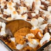 Sweet Potato Casserole being served with spoon
