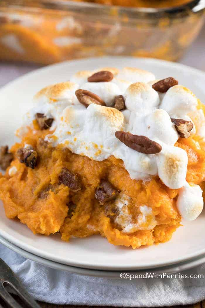 This easy Sweet Potato Casserole features buttery sweet potatoes, pecans and marshmallows. This is the perfect side dish for turkey dinner!