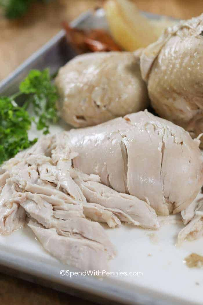 Cutting board with boiled chicken