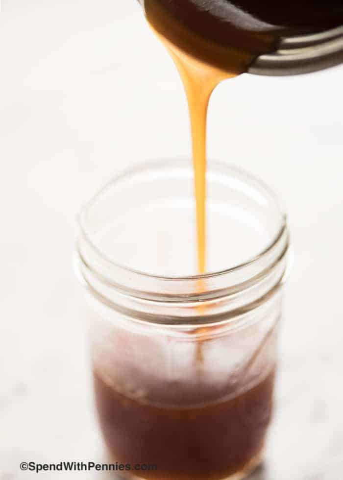Sweet & sour sauce being poured into a mason jar