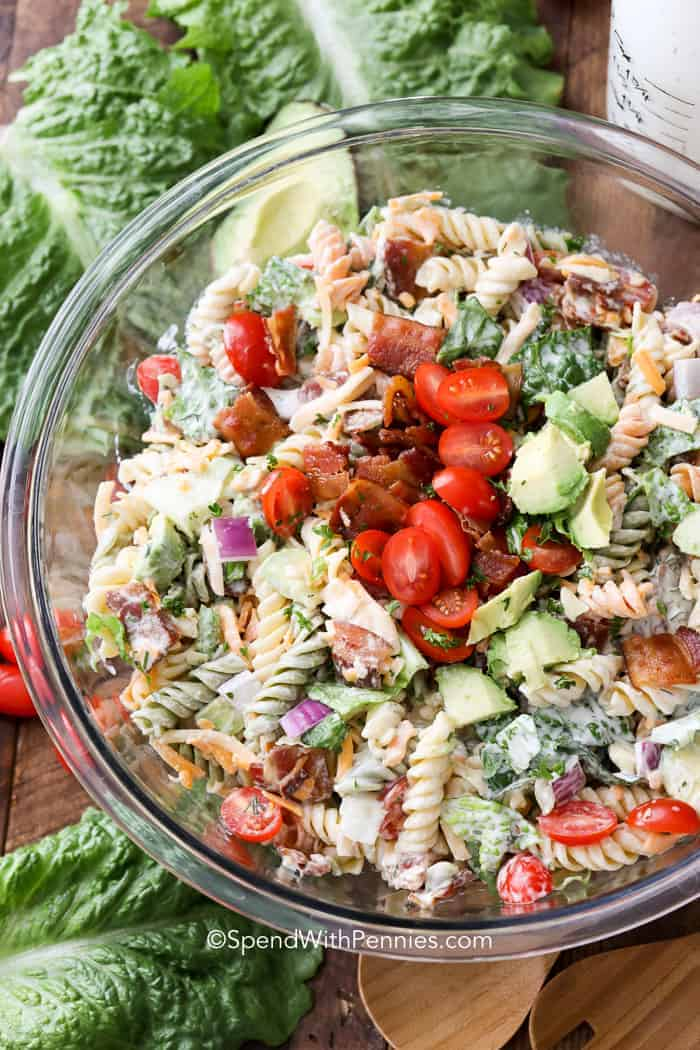 A bowl of BLT Pasta salad with lettuce.