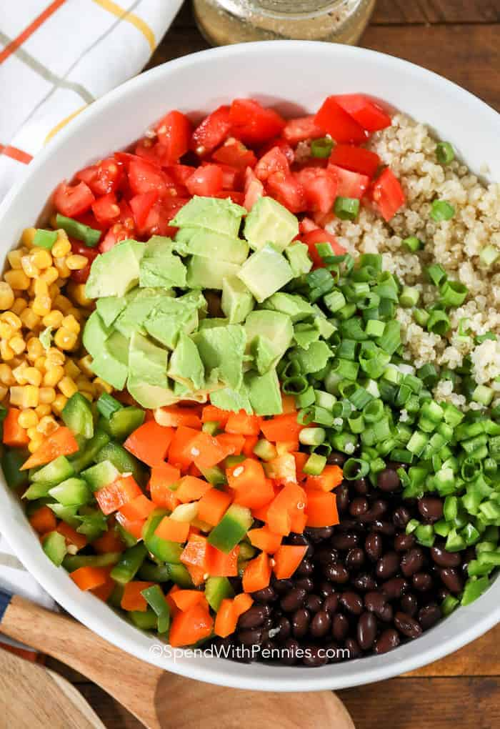 This quinoa was the first thing gone at our potluck! Black Bean Quinoa Salad features all of our favorite veggies in a zesty lime dressing!