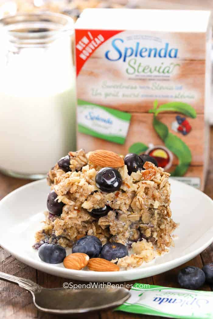 blueberry baked oatmeal on a plate with almonds and a bottle of milk