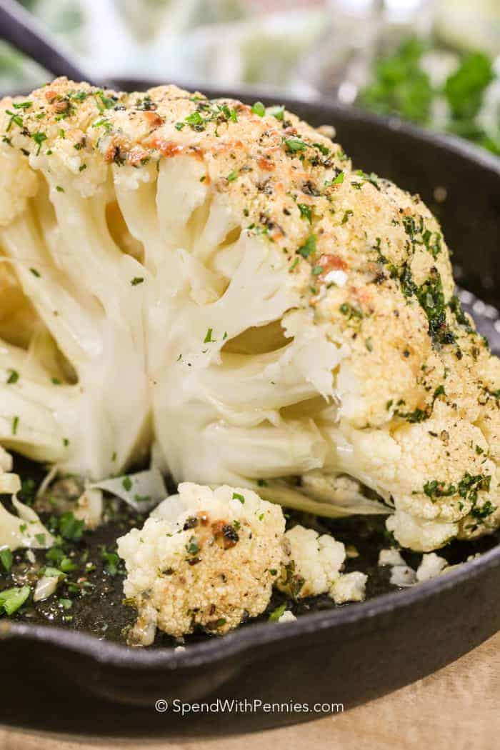 Whole Roasted Cauliflower in a cast iron pan