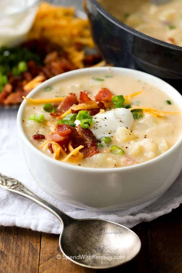White bowl with Baked Potato Soup and a spoon