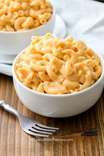 Instant Pot Mac and Cheese in a white bowl with a fork