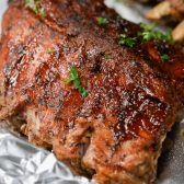 Instant Pot Ribs garnished with parsley on foil