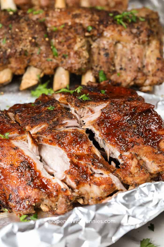 slab of barbecue ribs and dry ribs on foil