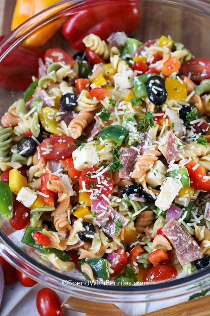 A bowl full of colorful Italian Pasta salad ready for a potluck!