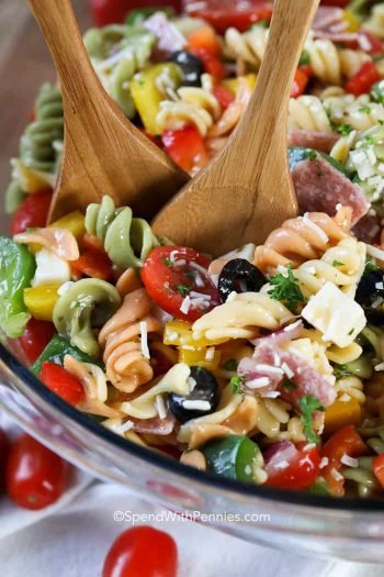 Italian Pasta Salad with spoons in a clear bowl