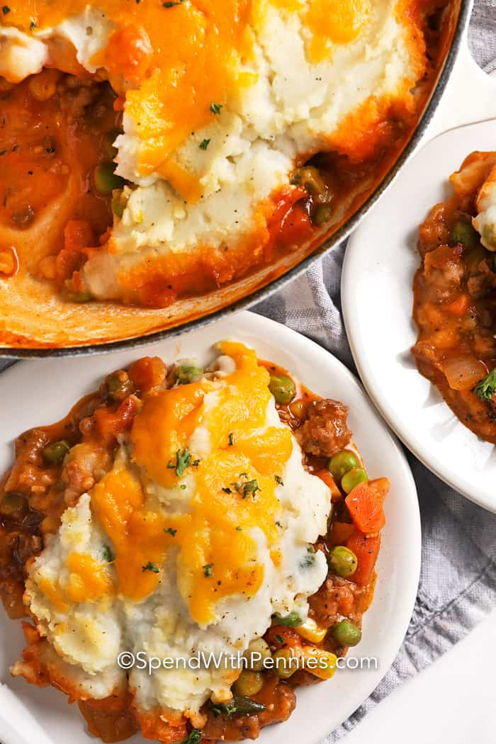 Shepherd's Pie served on white plates and topped with cheese