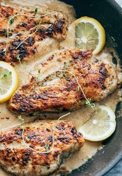 Closeup of creamy lemon thyme chicken in a pan