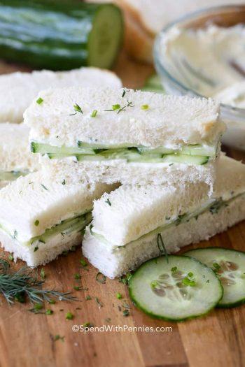 Cucumber Sandwich pieces on a wooden board