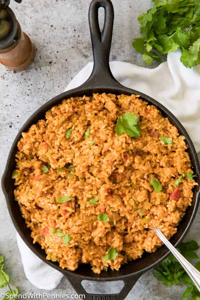 A skillet full of Mexican Rice with cilantro garnish