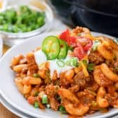 Taco Pasta Skillet on a plate with sour cream and jalapenos