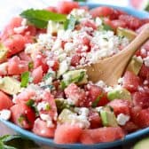 Watermelon Salad in a bowl with a spoon