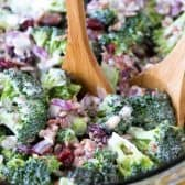 Broccoli Salad in a bowl with wooden spoons