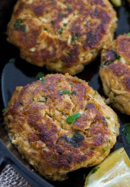 crab cakes in a cast iron pan