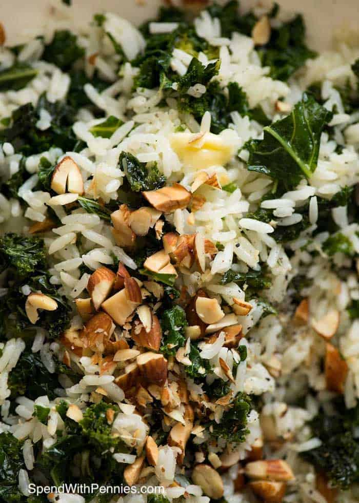 Close up of Garlic Butter Kale Rice with butter and almond garnish