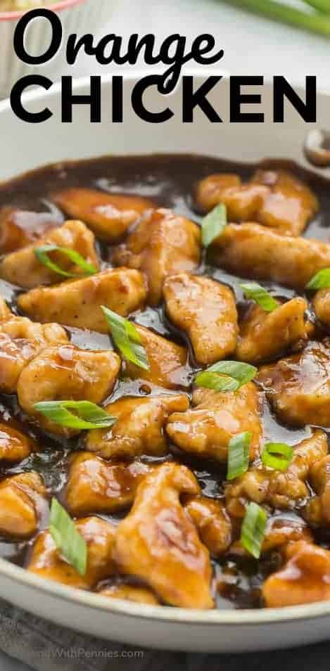 Skillet Orange Chicken in a white bowl garnished with green onion