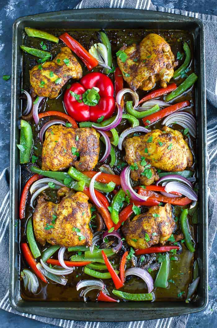 Chicken Shawarma with peppers and onion on sheet pan