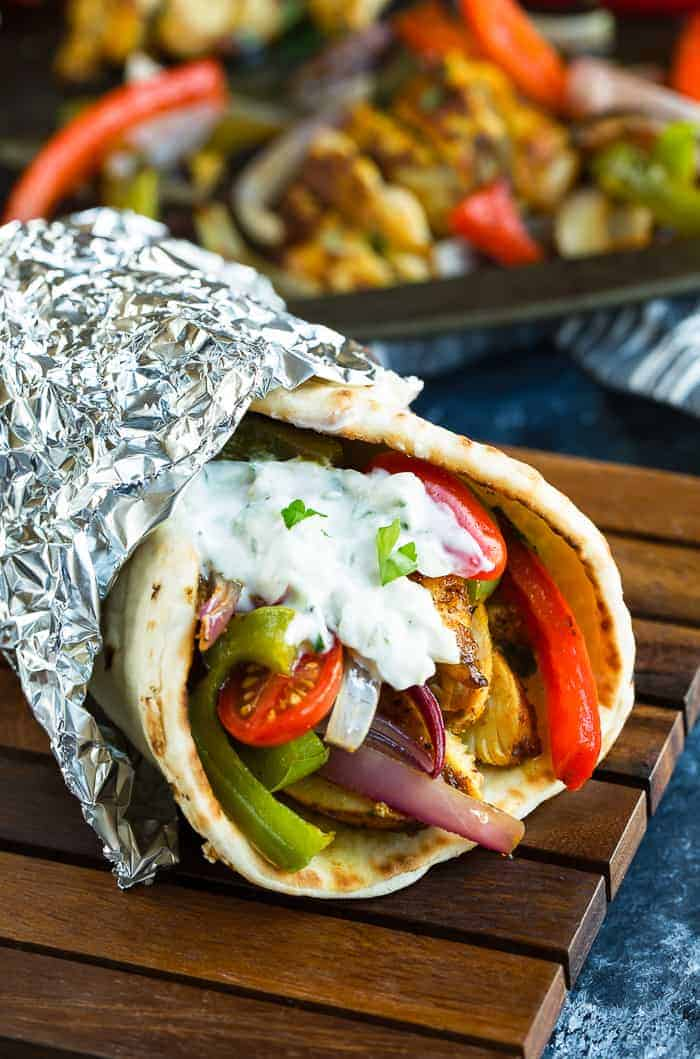 chicken shawarma served in pita with veggies and sauce