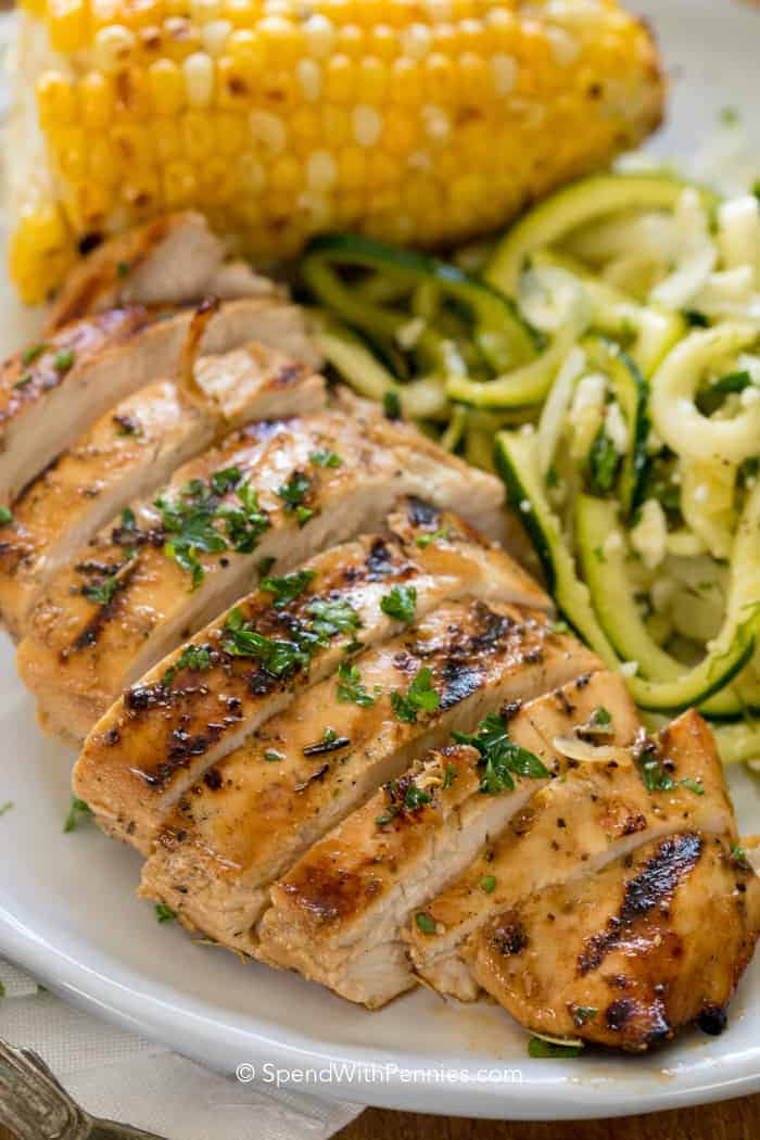 Easy Grilled Chicken Breast sliced and prepared to eat with corn and zucchini sides