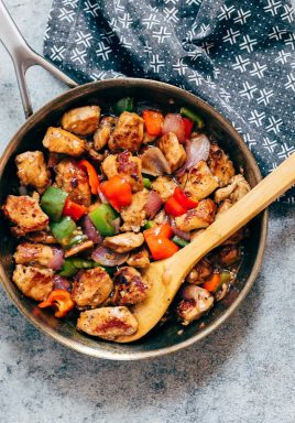 Pepper Chicken Stir Fry in a stainless steel pan