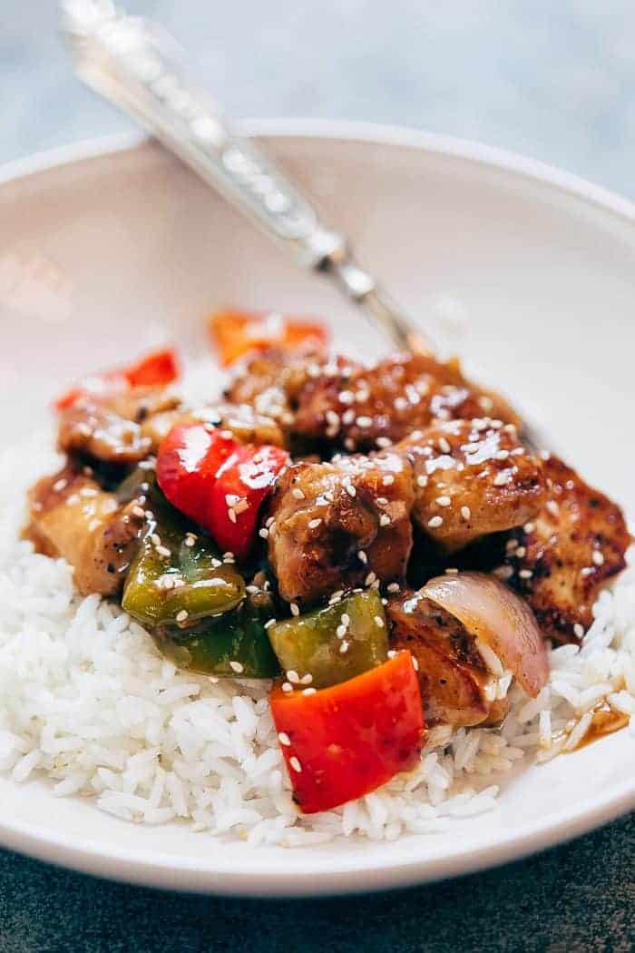 Pepper Chicken Stir Fry served in a bowl over white rice