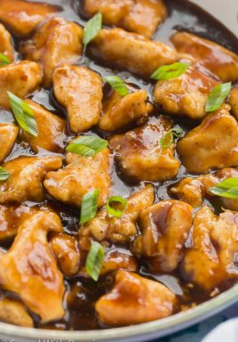 orange chicken close up in pan