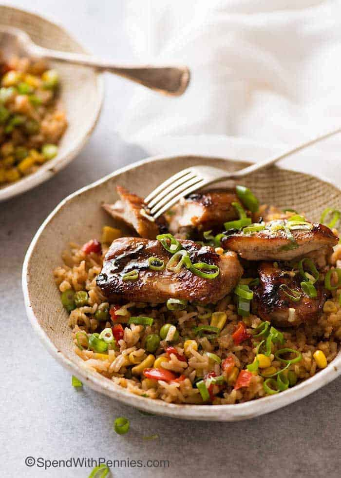 Chinese Chicken and Rice in a rustic brown bowl, ready to be eaten with a fork