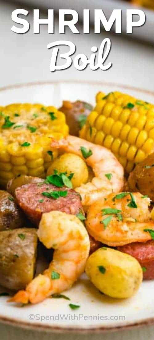 Sheet Pan Shrimp Boil is a delicious dish loaded with shrimp, sausage, corn, and potatoes and garnished with parsley and lemon juice for a fresh and flavorful summer meal. #spendwithpennies #shrimpboil #shrimprecipe #easyrecipe #simplerecipe #withsausage #summermeal #onasheet