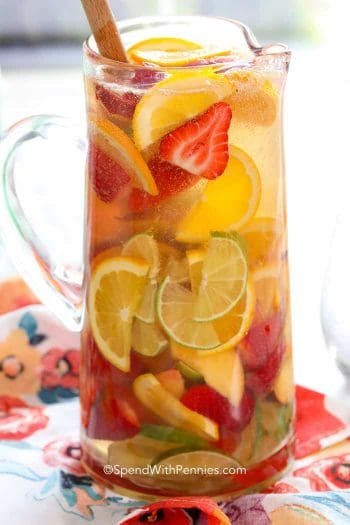 White Sangria with strawberries, limes and oranges
