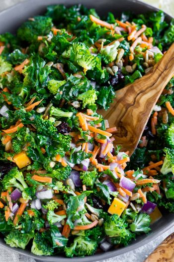 Easy Kale Salad in a bowl with a serving spoon