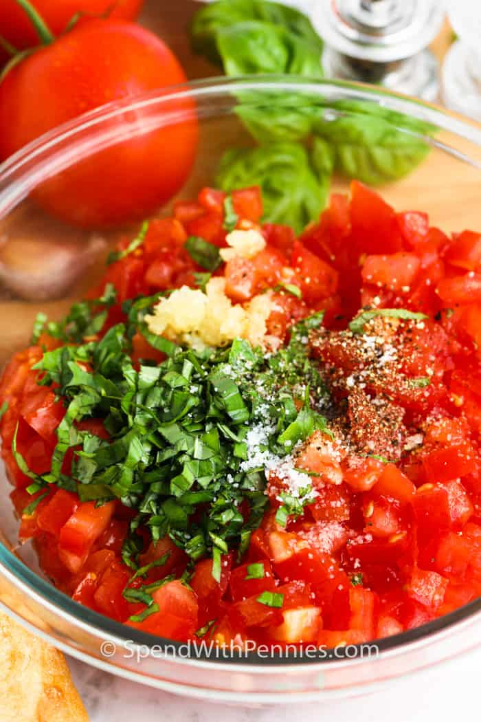 ingredients to make Bruschetta in a glass bowl