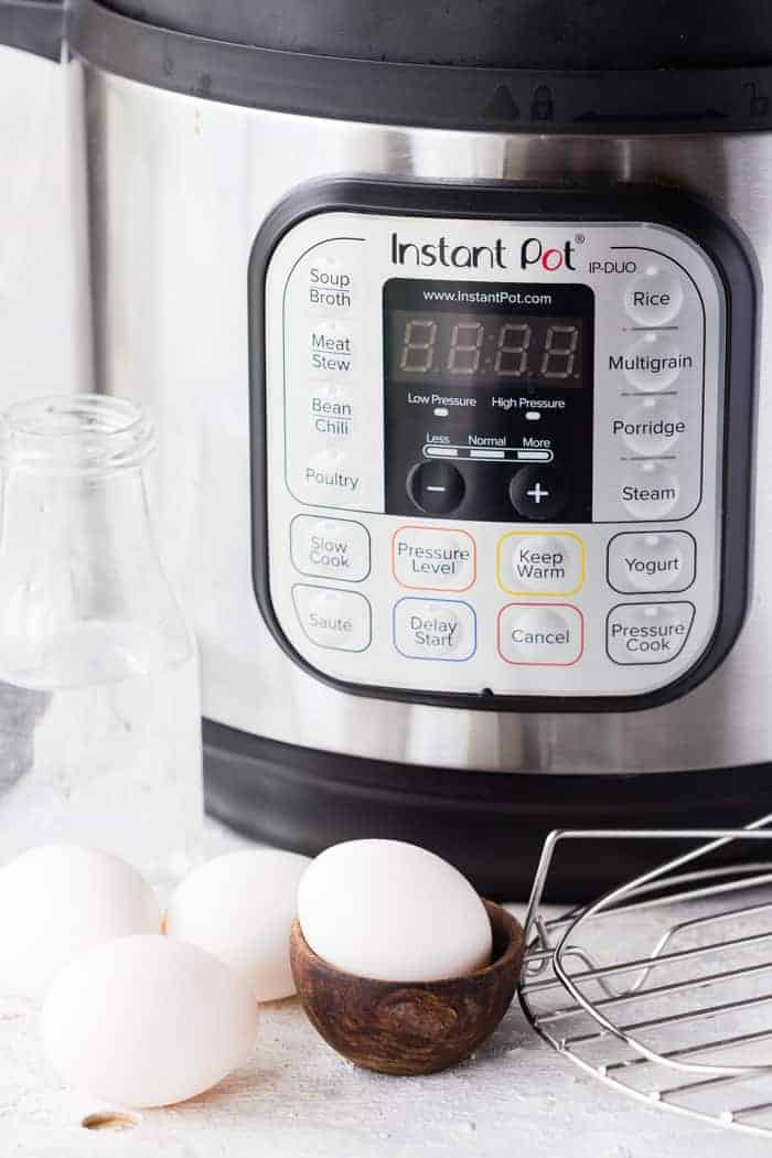Instant Pot in background, bottle of water, eggs