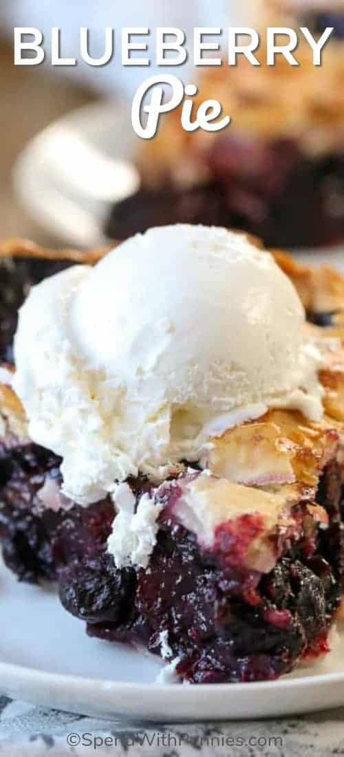 Blueberry Pie served on a white plate with ice cream on top