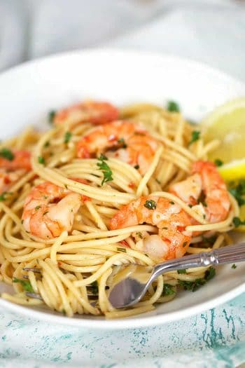 Shrimp Scampi with a fork in a white bowl