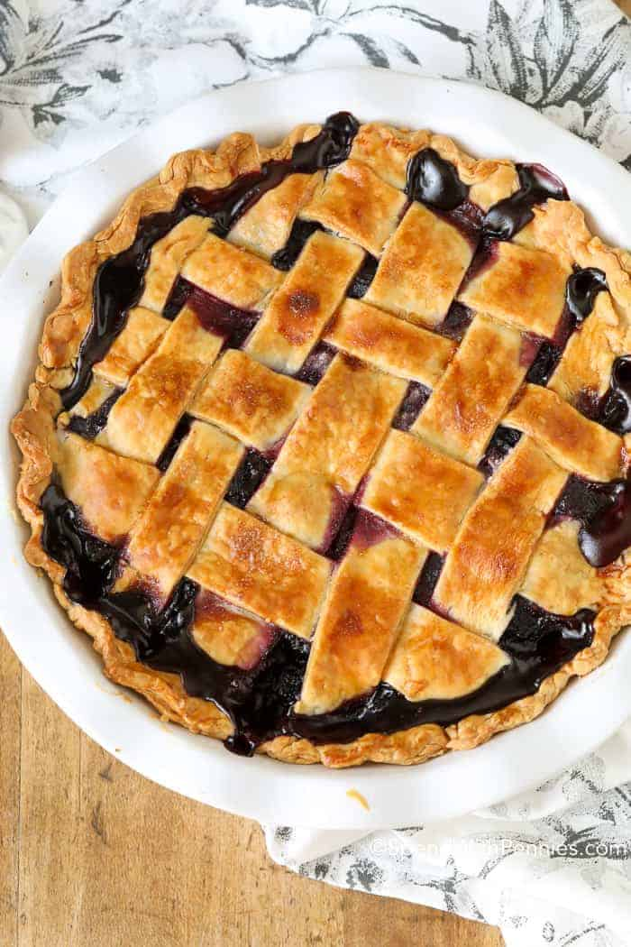 A baked Blueberry Pie with a lattice crust.