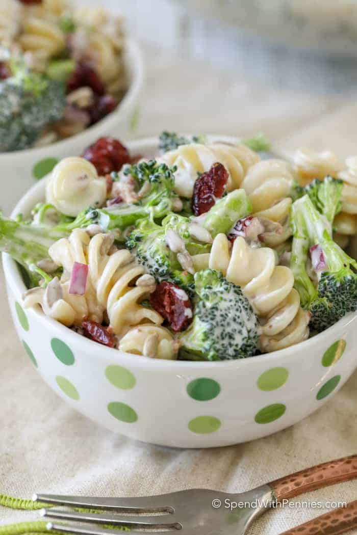 Broccoli Pasta Salad served in white bowl with green dots