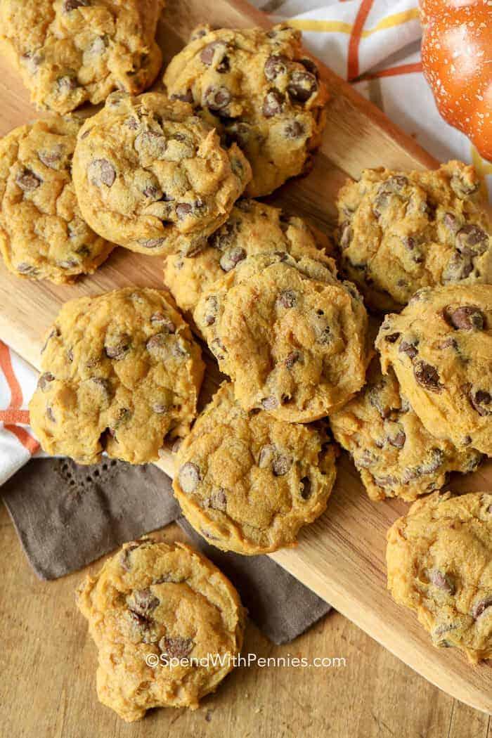 Pumpkin Chocolate Chip Cookies scattered on a wooden board