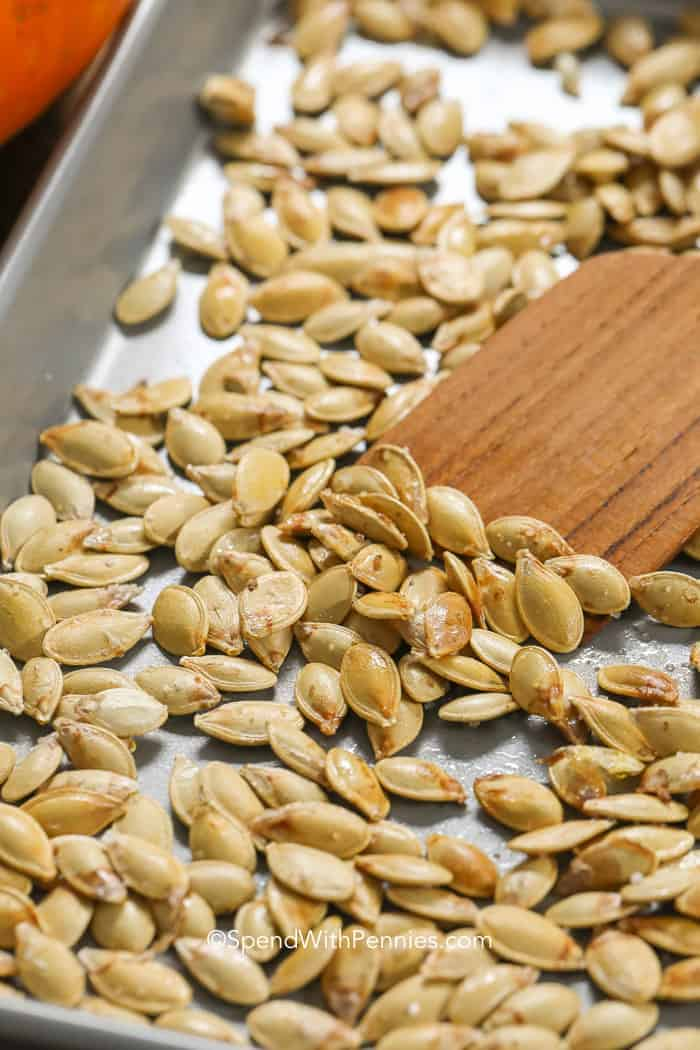 Roasted Pumpkin Seeds being tossed while baking