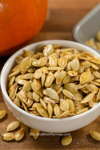 White bowl of Roasted Pumpkin Seeds