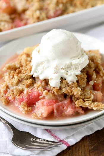 Rhubarb Crisp served on a white plate with ice cream on top