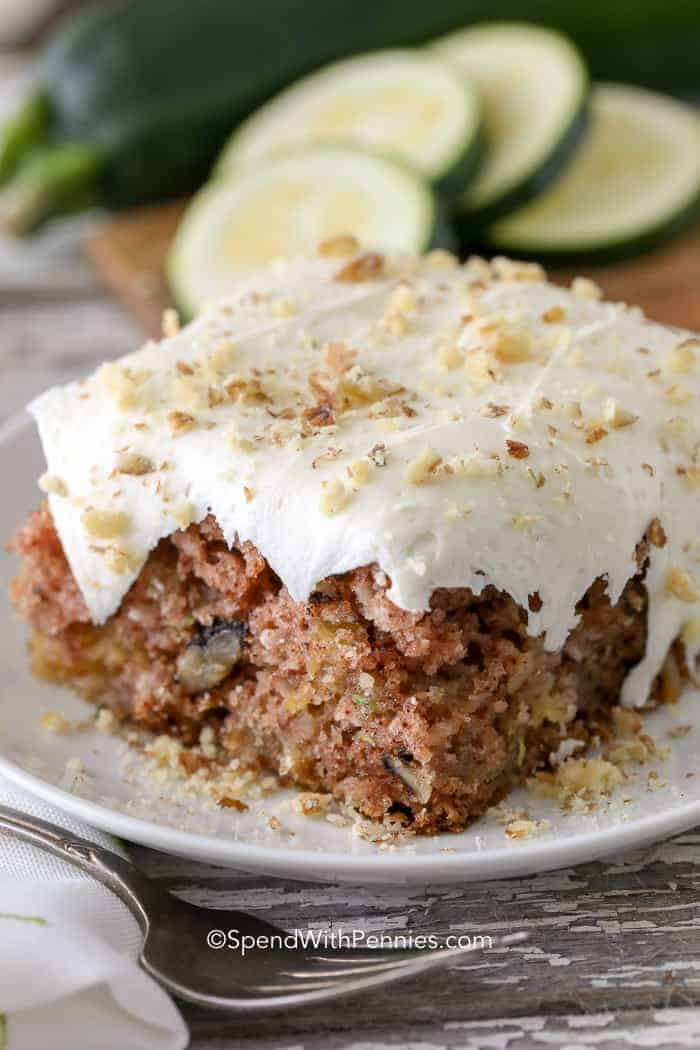 A slice of zucchini cake on a white plate