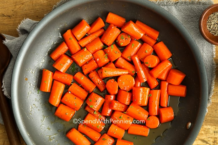 Glazed carrots in a frying pan