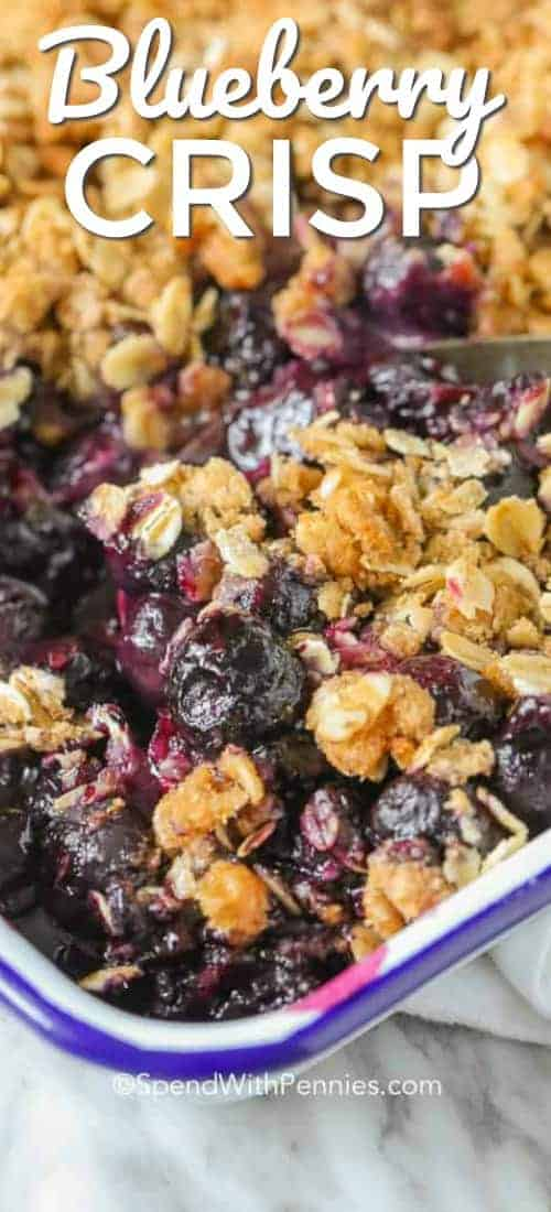 Baking dish full of Blueberry Crisp with a title