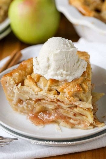 Homemade Apple Pie with vanilla ice cream on a white plate